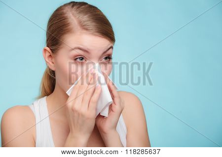 Flu cold or allergy symptom. Sick woman girl sneezing in tissue on blue. Health care. poster