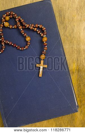 Catholic Cross On The Book