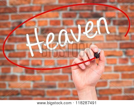 Man Hand Writing Heaven With Black Marker On Visual Screen