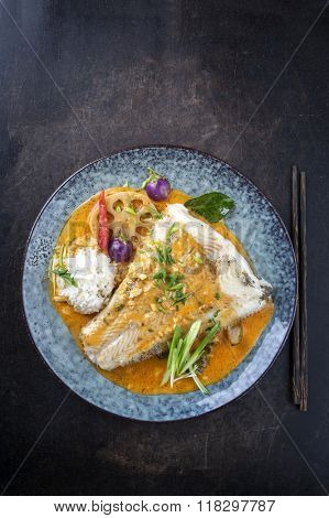 Thai Curry with Halibut Filet on Plate