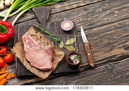 Fresh Piece Of Pork On The Bone With Vegetables