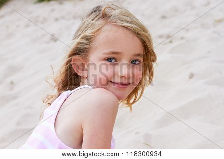Portrait Of Young Girl Playing On Beach
