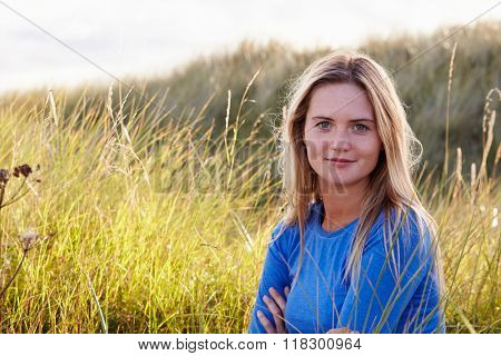 Portrait Of Woman Sitting In Sand Dunes