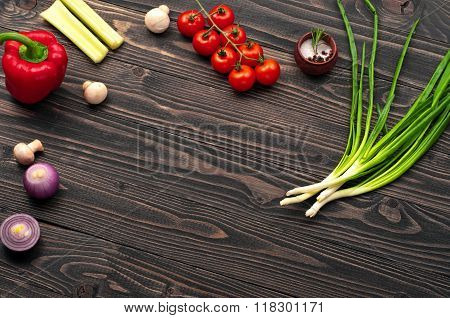 On A Dark Wooden Surface, Tomatoes, Onions, Mushrooms And Peppers