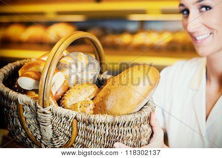 Baker woman in backer selling bread in basket, filtered image