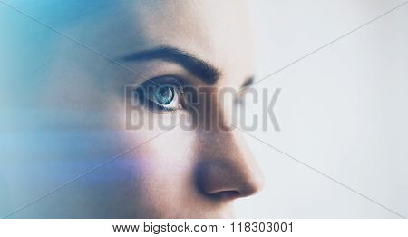 Closeup of woman eye with visual effects, isolated on white background. Horizontal