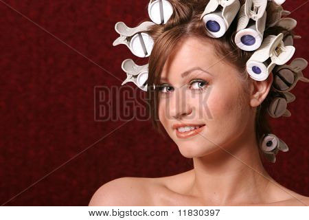 Beautiful woman in hair rollers