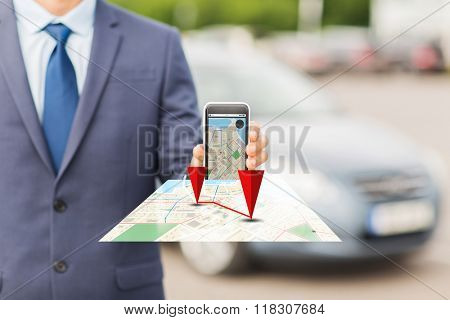 transport, business trip, technology, navigation and people concept - close up of man showing smartphone gps navigator map on screen on car parking poster