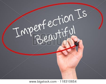 Man Hand Writing Imperfection Is Beautiful With Black Marker On Visual Screen