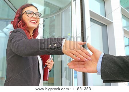 business meeting welcoming smile and handshake