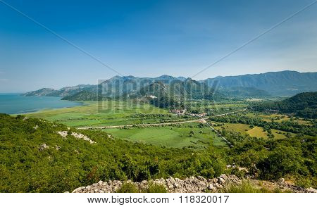 Montenegro summer landscape with Virpazar town - popular touristic resort on Skadar lake national park. Aerial view from the old mountain road. poster