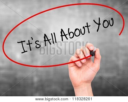 Man Hand Writing It's All About You With Black Marker On Visual Screen