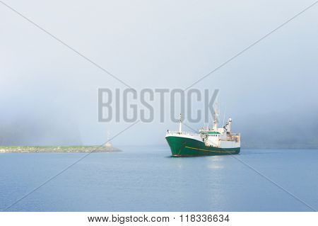 Ship sailing in a foggy weather