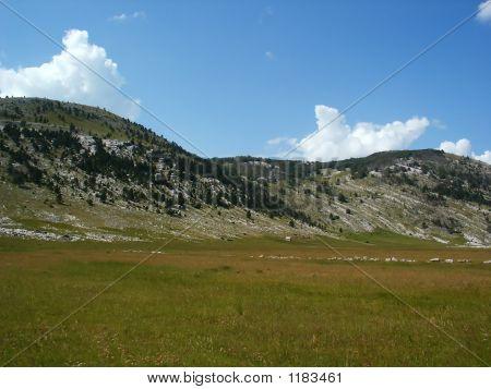 Mountain Landscape In Croatia Over Clouds Background