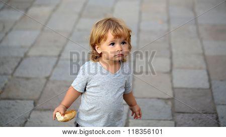 Portrait Of Blond Hazel-eyed Kid