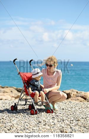 Mother And Baby In Stroller