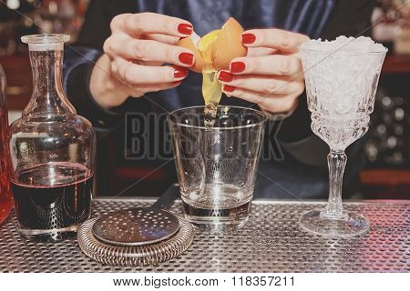 Bartender is adding egg white to the glass, toned