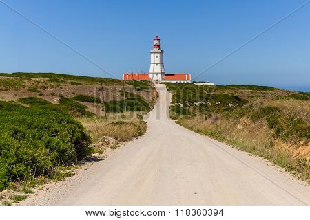 The dirt road leading to the Espichel Cape lighthouse. Built during the 18th century is one of the oldest lighthouses in Portugal and guides boats and ships in the Atlantic Ocean. Sesimbra, Portugal.
