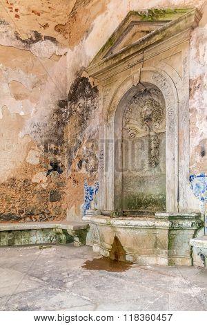 Interior of the vandalized Casa da Agua (Water House), an 18th century fountain and reservoir built for the pilgrims of the Nossa Senhora do Cabo Sanctuary. Espichel Cape, Sesimbra, Portugal.