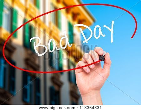 Man Hand Writing Bad Day  With Black Marker On Visual Screen