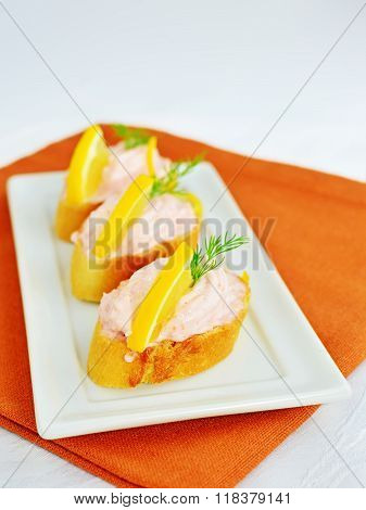 Taramasalata Canape, Fish-roe Spread Bites With Lemon Slices Over Bread