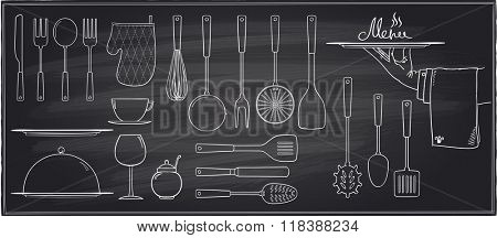 Set of kitchen utensils and tableware on a chalkboard background