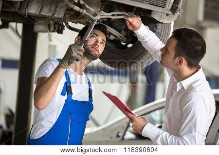 assessor and repair man examine to the car damage