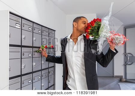 Lover boy puts roses in the letter box of the beloved