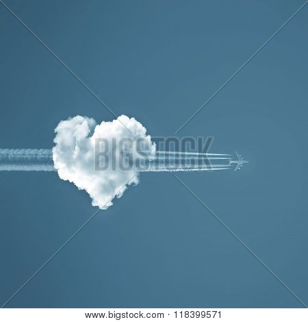 Love is in the air, heart shaped cloud and airplane arrow ** Note: Visible grain at 100%, best at smaller sizes