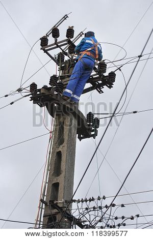 Electrician working, repairing the power line .