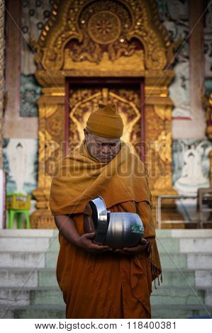 Thai Monk recieving morning alms