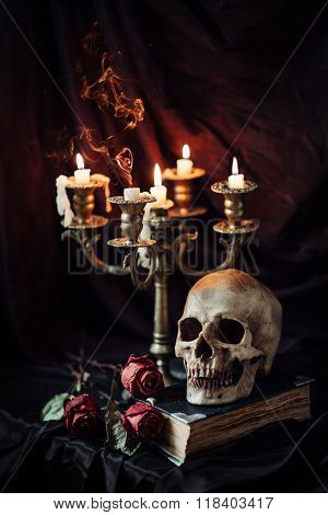 Still life with skull, book and candlestick