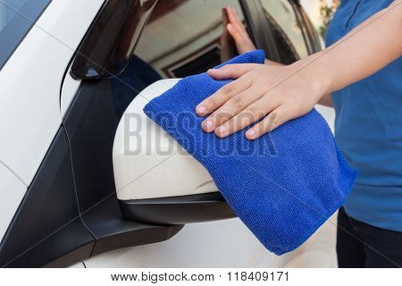 Hand With Microfiber Cloth Cleaning Wing Mirror Car