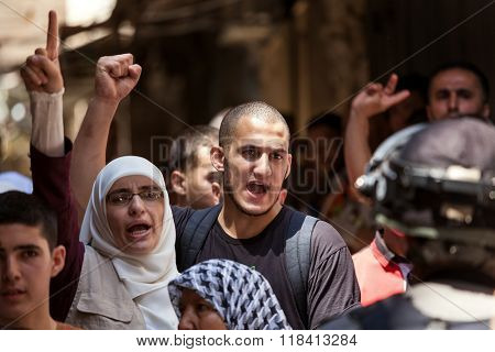 JERUSALEM, ISRAEL - JULY 26, 2015: Palestinians in Old City of Jerusalem protest against ascent of religious jews to Temple Mount during Tisha B'Av - important annual fast day in Judaism.
