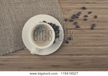 Fresh coffee beans on wood and linen