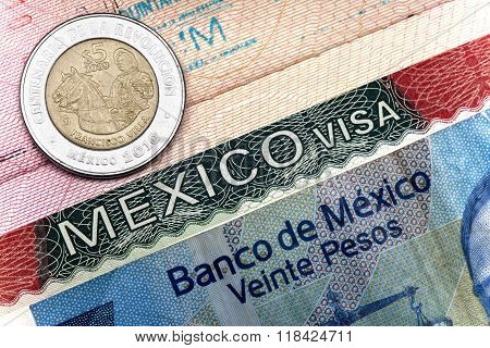 The visa of Mexico in the Russian international passport and Mexican pesos