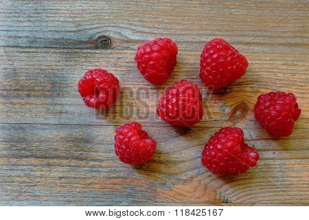 Fresh Red Berries Raspberry European On A Wooden Surface
