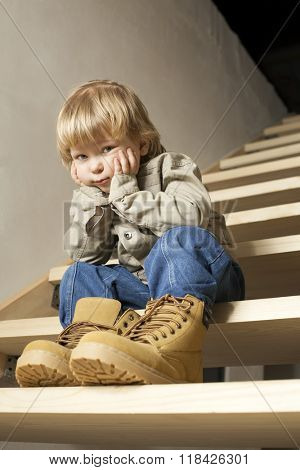 Big shoes to fill, child's feet in large shoe