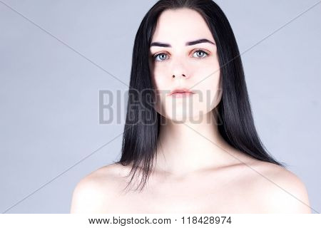Young beautiful brunette with gray eyes and fair skin