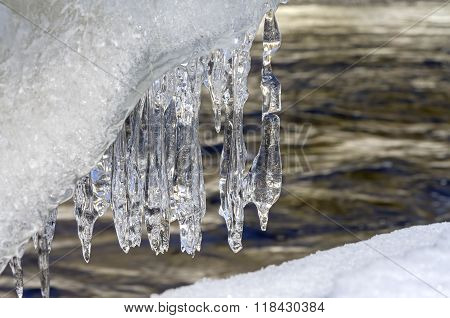 Whimsical Garland Of Icicles Above A River
