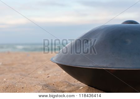 Relax music background. Hands percussion. The Hang or handpan with sea On Background. the hang is a