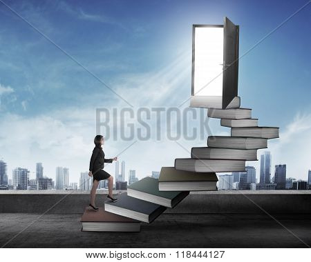 Asian Business Woman Stepping Up Stair Made From Book