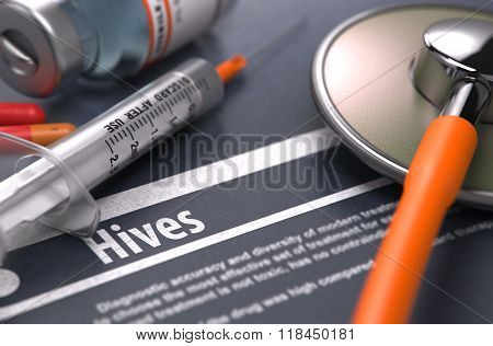 Hives - Printed Diagnosis on Grey Background.