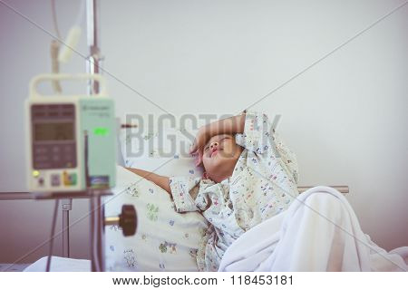 Asian Boy Sleeping On Sickbed With Infusion Pump Intravenous Iv Drip. Retro Style.