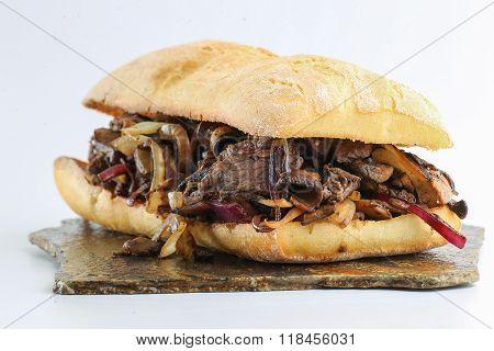 Tasty beef steak onion mushroom sandwich