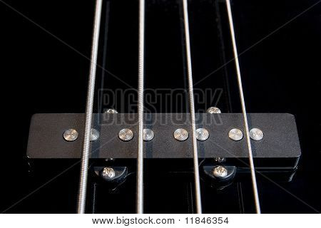 black bass guitar pickup with strained strings