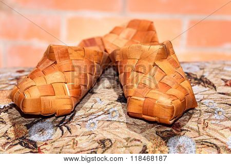 Pair Of Russian Bast Shoes On Patterned Cloth