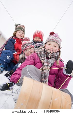 Children on toboggan