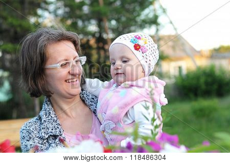 Cheerful Mother And Baby Outdoor