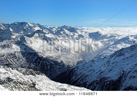 Austrian Alpine Valley Covered By Sea Of Clouds.